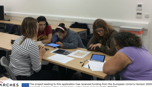 5 participants sitting around a table with a iPads