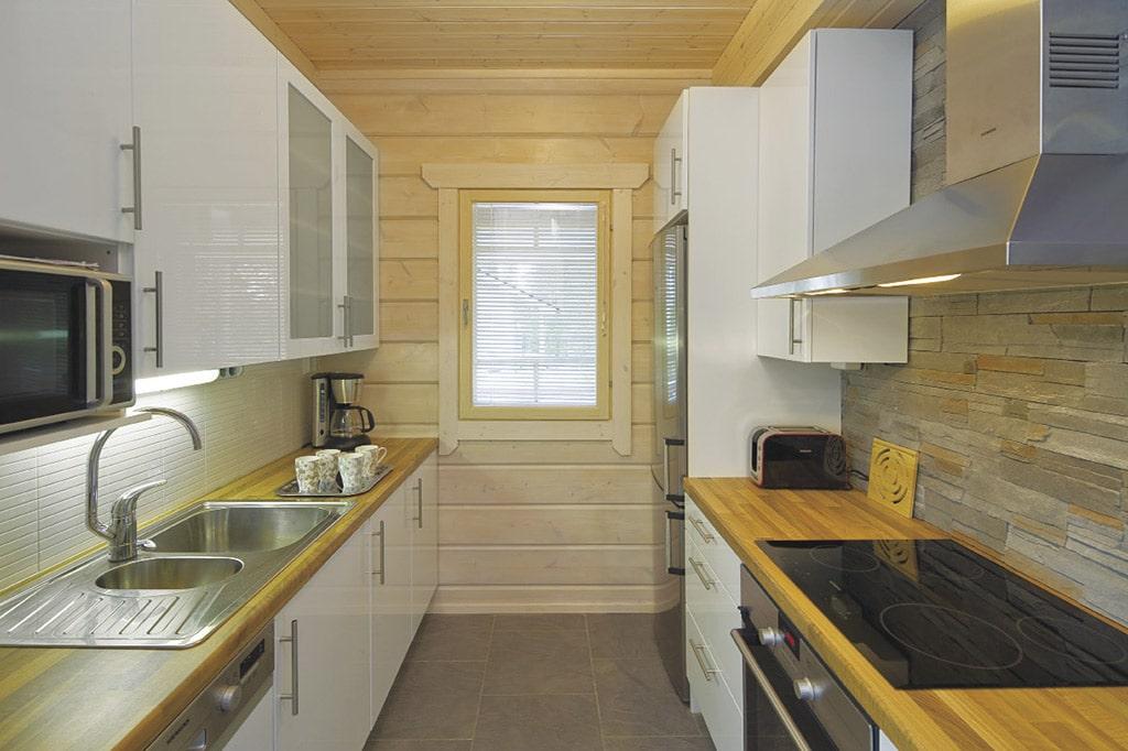 cuisine classique en bois dans maison bois moderne Caroline Barrès et Thierry Coquet Architectes / Erick Saillet