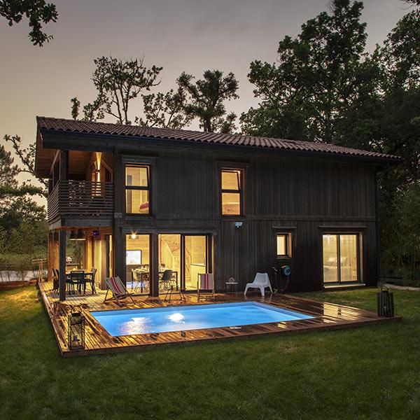 Maison bois en madriers avec piscineà Moliets-et-Maa