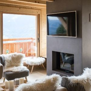 séjour confortable en bois dans chalet bois au Suisse