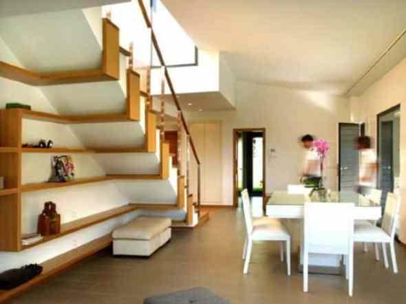 artful shelves under the stairway