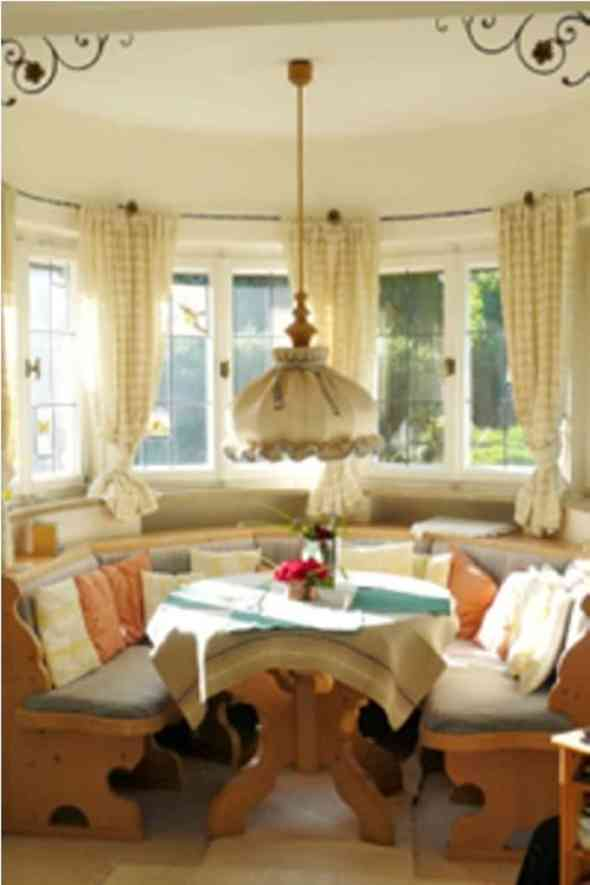 cottage style dining room with floral and check motif