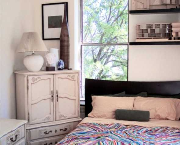 small bedroom with simple furniture