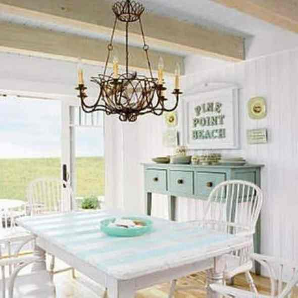 white cottage style dining room with antique lamp