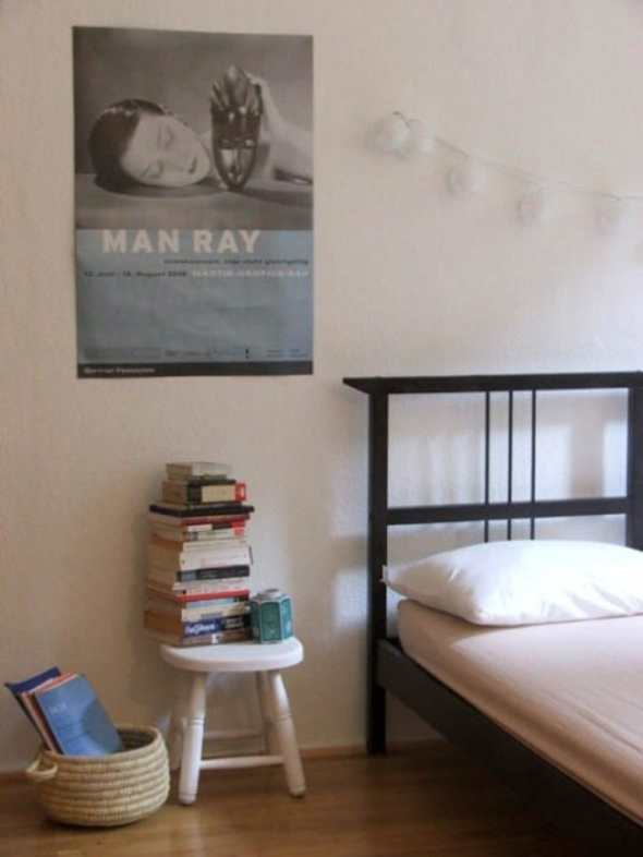 Bedroom with museum poster as the bedroom wall art