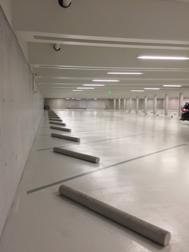 This is so selective of a material palette that even the parking is all white. Actually, I have no idea why this whole garage is white, but it's kind of bright and stupefying. How often do you see a completely white parking garage?