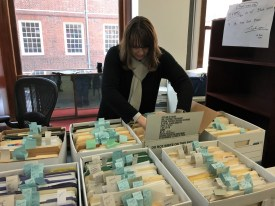 Corinne Bermon working at the National Park Services archives in Boston.