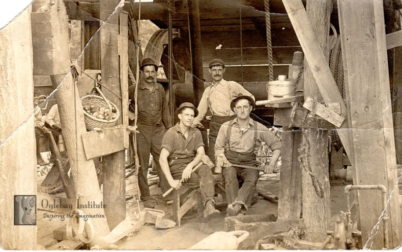 This real photo postcard was sent by one of the men in this picture to his cousin in Colorado. He indicates that the group photographed is his work crew and that he would like to move west and work for the rail road with his cousin. From the Ellen Dunable Postcard Collection, Museums of Oglebay Institute