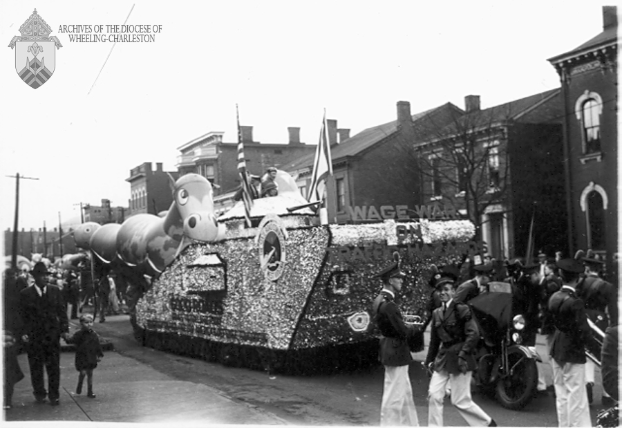 Like Cooey-Bentz, the State Road Commission sponsored a high tank float, in the latter case urging good roads — because nothing is better for your roads than a 30-ton, pavement gouging, military tank.