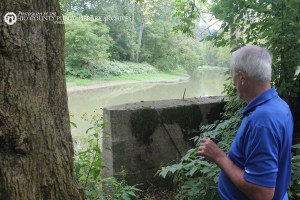 George examines the ruins of the old bridge that once carried golfers across Big Wheeling Creek back to the club house at Cedar Rocks.
