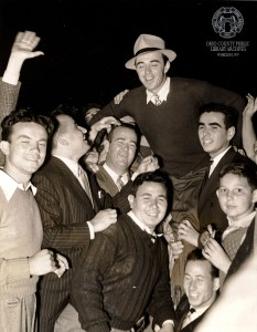 In this photo, taken just ten days after his victory at Cedar Rocks, Sam Snead is carried by fans after a victory in the Westchester 108-hole Open in White Plains, NY.