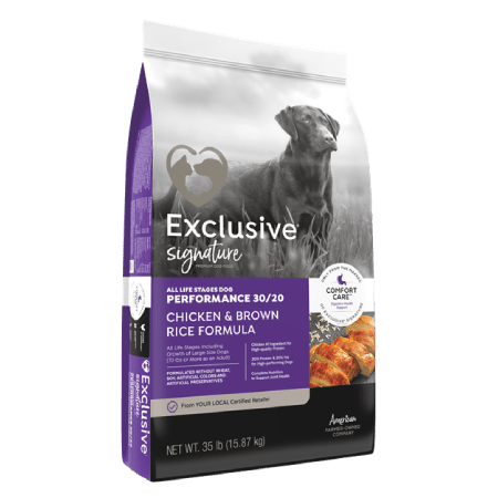 Exclusive Signature Performance 30/20 Chicken & Brown Rice Formula Dog Food in purple black and grey bag with dog