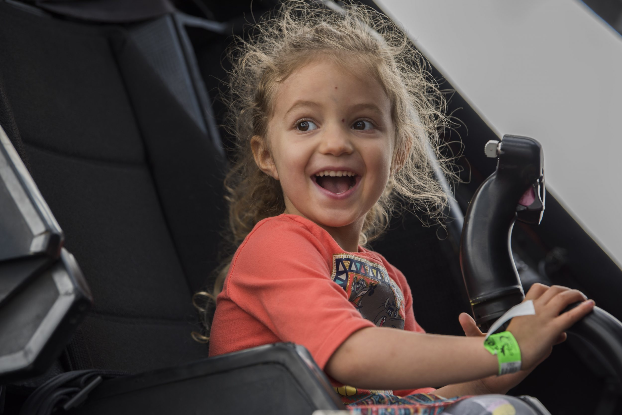 Emily Butcher, 4, sits in a U.S. Army AH-64 Apache attack helicopter during the Arctic Thunder Open House at Joint Base Elmendorf-Richardson, Alaska, June 30, 2018. During the biennial open house, JBER opens its gates to the public and hosts multiple performers including the U.S. Air Force Thunderbirds, JBER Joint Forces Demonstration and the U.S. Air Force F-22 Raptor Demonstration Team. (U.S. Air Force photo by Airman 1st Class Caitlin Russell)