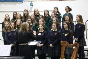 Ms Jackson and the school choir in action at Ardscoil Mhuire 100 Hritage Day