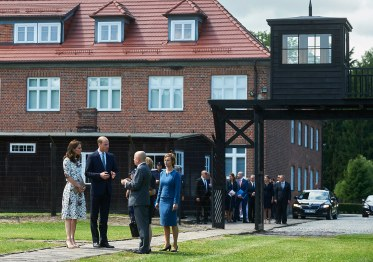 epa06094535 Britain's Prince William, Duke of Cambridge (2-L) and Catherine, Duchess of Cambridge (L) and Director of the Stutthof Museum Piotr Tarnowski (3-L) during a visit to the Former Nazi-German Concentration Camp KL Stutthof in Sztutowo village, northern Poland, 18 July 2017. The Duke and Duchess of Cambridge are on a first official visit to Poland. EPA/DOMINIK KULASZEWICZ POLAND OUT
