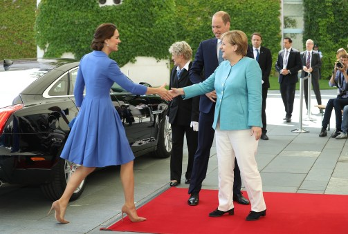BERLIN, GERMANY - JULY 19: German Chancellor Angela Merkel welcomes Catherine, Duchess of Cambridge, and Prince William, Duke of Cambridge, at the Chancellery on the first day of their visit to Germany on July 19, 2017 in Berlin, Germany. The royal couple are on a three-day trip to Germany that includes visits to Berlin, Hamburg and Heidelberg. (Photo by Sean Gallup/Getty Images)