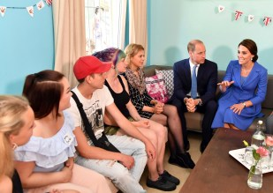 Britain's Prince William. second right, and his wife Kate, the Duchess of Cambridge, right, talk to adolescents in the Bolle children's and youth centre in Berlin, Germany, Wednesday, July 19, 2017. (Jens Kalaene/dpa via AP)