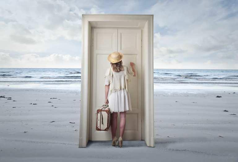 woman knocking on door at beach