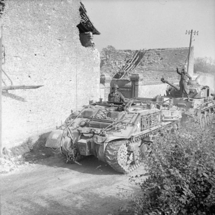 A Sherman ARV towing a German PzKpfw IV tank captured near Cagny, 19 July 1944.