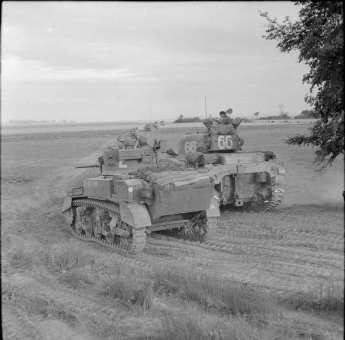 A Stuart and Sherman tanks of 33rd Armoured Brigade during Operation 'Charnwood', the attack on Caen, 8 July 1944.