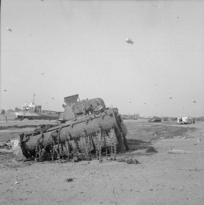 A disabled Sherman Crab flail tank of the Westminster Dragoons, 79th Armoured Division, on Sword Beach, 7 June 1944.