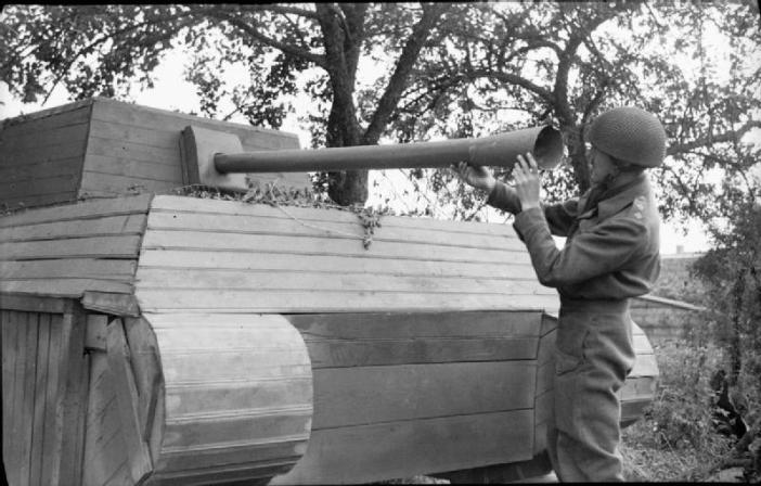 An officer inspects a German dummy tank made of wood, 31 July 1944.