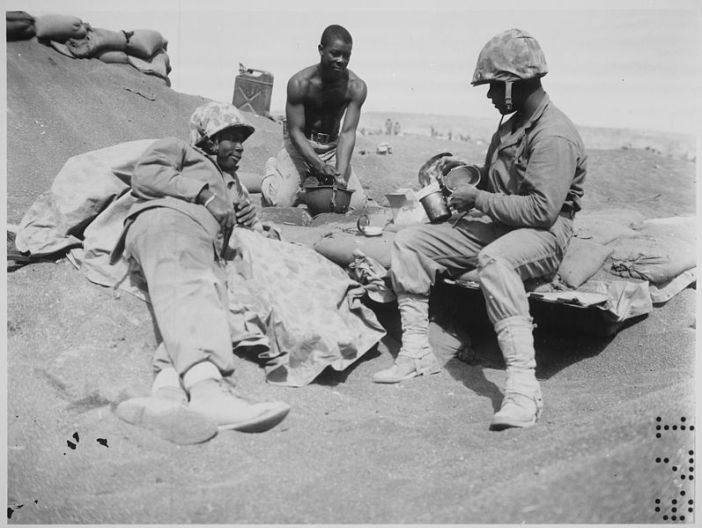 Iwo Jima...Negro Marines on the beach at Iwo Jima are, from left to right, Pfcs. Willie J. Kanody, Elif Hill, and John Alexander