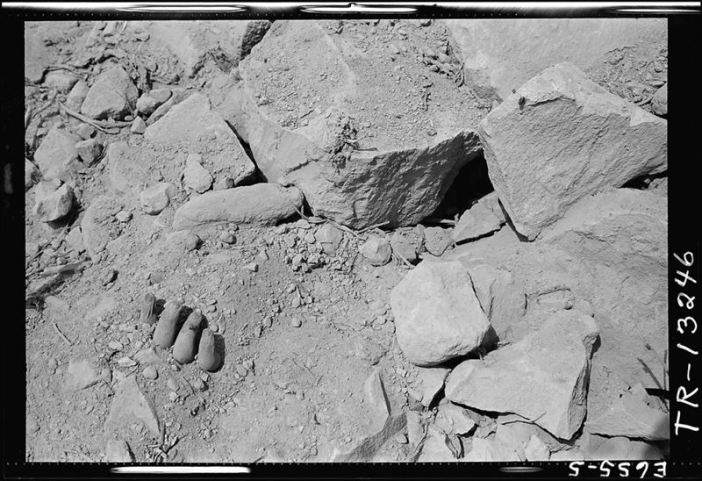 Results of one of the war's fiercest struggles, the fight for Iwo Jima, lie in sorry heaps all over the island. The hand of a Japanese soldier killed by a bomb blast is seen in the rubble which covered the island.