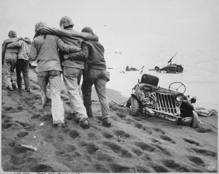 They did their part. Wounded Marines are helped to an aid station by Navy corpsmen and Marine walking wounded. Iwo Jima, circa February/March 1945.