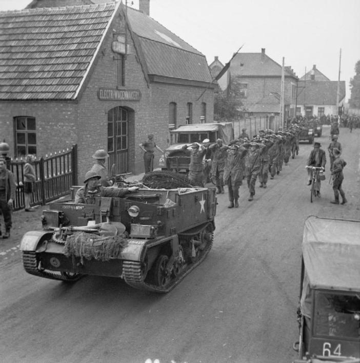 Bren Gun Carrier (Universal/Windsor) brings in a batch of German prisoners during 158 Brigade's attack.