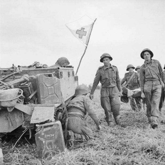 A British casualty is brought back to a Universal Carrier being used to evacuate wounded, 49th (West Riding) Division, Operation 'Epsom', Normandy, 27 June 1944.
