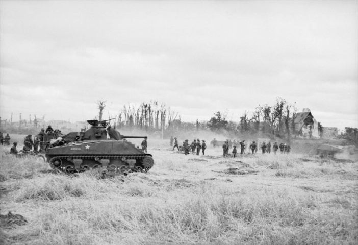 British Sherman tanks and infantry during the advance on Caen, Normandy, 9 July 1944.
