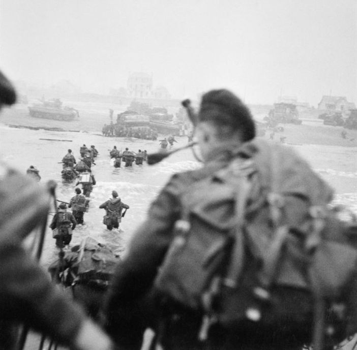Commandos of 1st Special Service Brigade led by Brigadier Lord Lovat land on Queen Red beach, Sword area, c. 0840 hours, 6 June 1944.