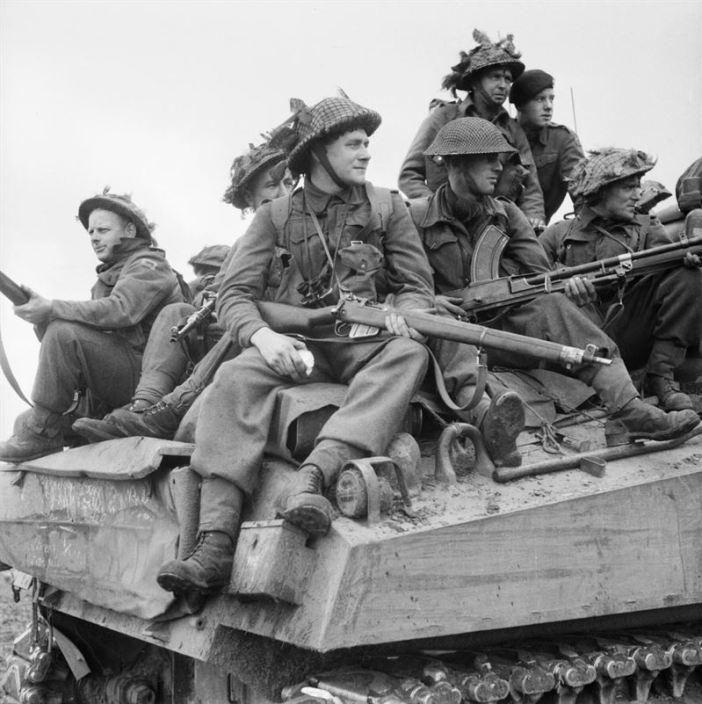 Infantry ride on Sherman tanks in Holland, 24 September 1944