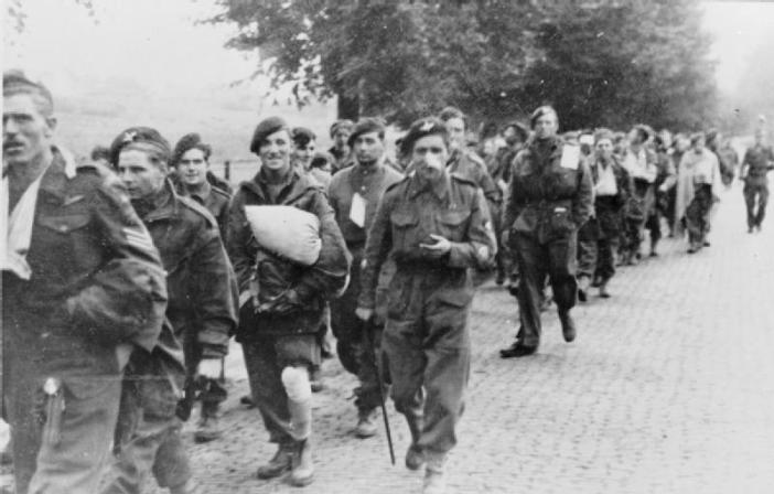 British paratroops being marched away by their German captors. Some 6,400 of the 10,000 British paratroops who landed at Arnhem were taken prisoner, a further 1,100 had been killed.