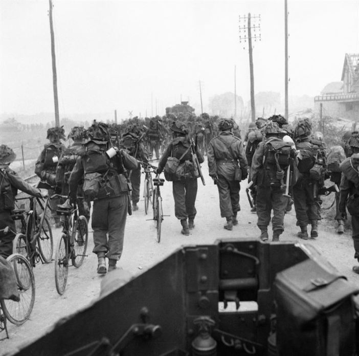 Troops from 3rd Division, some with bicycles, move inland from Sword Beach, 6 June 1944. Photograph taken from a Universal carrier.