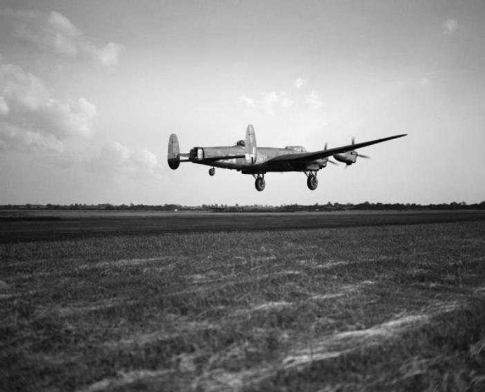 Avro Lancaster B Mark III, ED831 'WS-H', of No 9 Squadron RAF, flown by Squadron Leader A M Hobbs RNZAF and his crew, taking off at Bardney, Lincolnshire, for a raid on the Zeppelin works at Friedrichshafen, on the shores of Lake Constance (Bodensee), Germany.