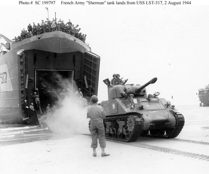 This tank, named Ile-de-France, belongs to the 12e Régiment de Chasseurs d'Afrique who was previously fielding SOMUA S35 tanks lands on Utah beach from USS LST-517, 2 August 1944.