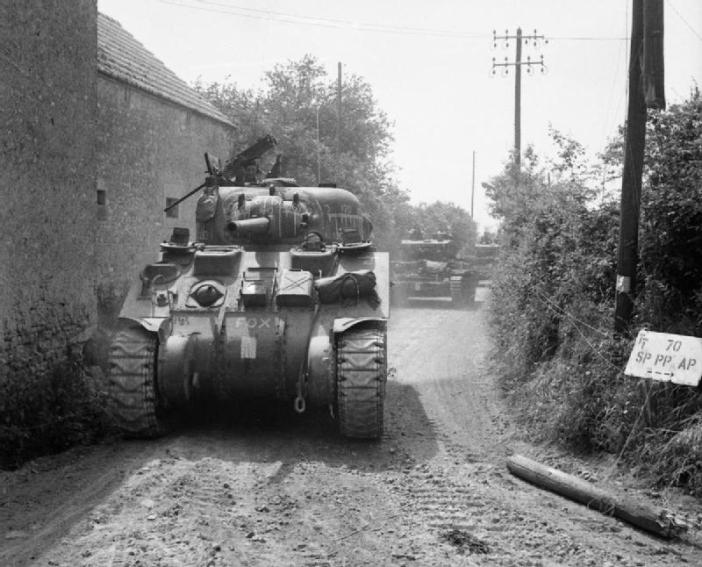 Sherman and Cromwell tanks of the Royal Marines Armoured Support Group near Tilly-sur-Seulles on June 13, 1944.