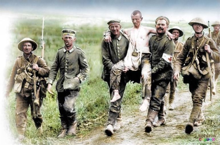 British soldiers with wounded German prisoners, La Boisselle, 22 miles (35 km) north-east of Amiens. 3rd of July 1916.