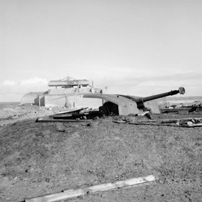 The occupation of Walcheren Island is going fast. Flushing is in the hands of the British and troops fanning out to the West are close to the Marine Commandos coming down from the Westkapelle beachhead (where these pictures were taken). This image shows German coastal guns and blockhouses which the British forces quickly put out of action on Walcheren Island.