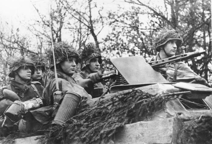Young German soldiers in a Sdkfz near the Belgian-Luxembourg border during the Ardennesoffensive