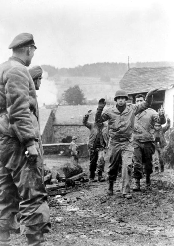 American soldiers of the 3rd Battalion 119th Infantry Regiment are taken prisoner by members of Kampfgruppe Peiper in Stoumont, Belgium on 19 December 1944