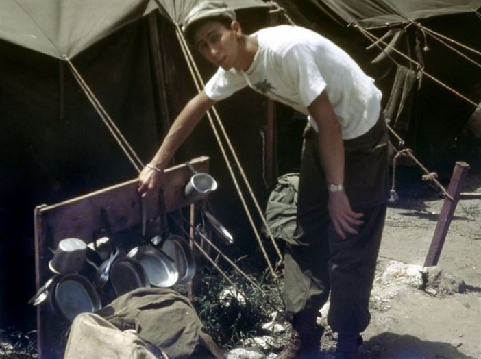 Jerry ready for dinner. Mess kits stored for the squad of 14 living in this tent on the Southern tip of Okinawa. Company moved here to hold the southern tip after it was (supposedly) cleared of enemy forces.