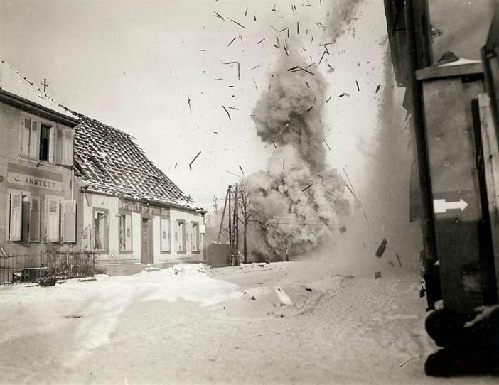 A German bridge is blown sky high by U.S. Engineers, destroying span as a defensive measure against German troops pressing towards the town.