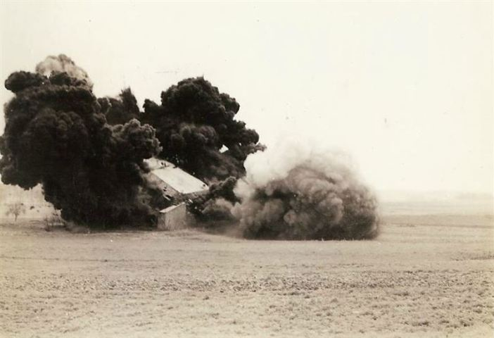 English M-5 Anti-tank mines are used to blow up German Pill Boxes. 400 lbs of TNT are being set off inside the pill box.