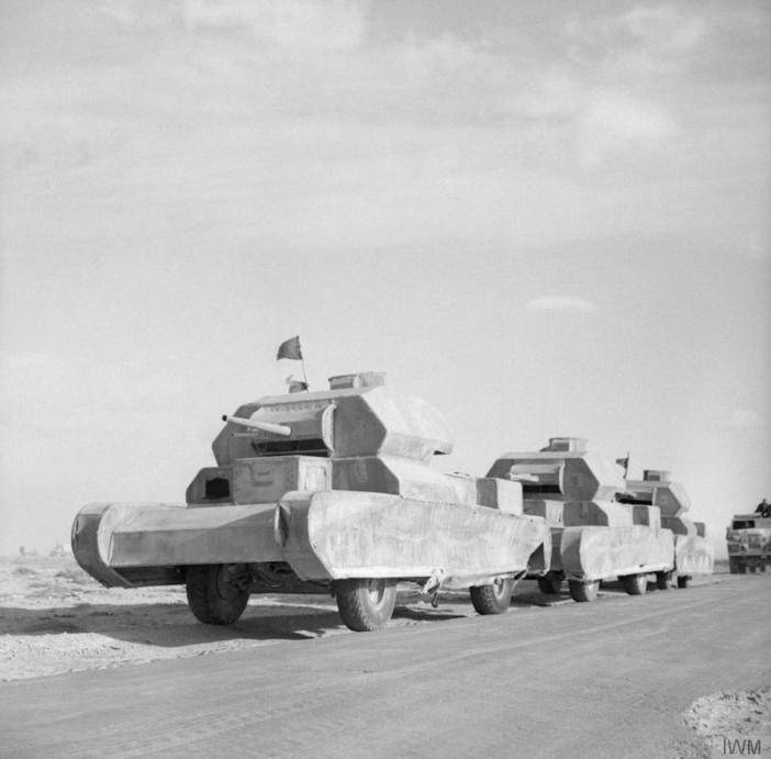Dummy tanks, mounted on trucks, going to the forward areas in the Western Desert, 13 February 1942. (Credits: © IWM (E 8361))