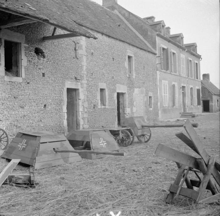 German dummy tank turrets and anti-tank guns found in a farmyard on the road to Livarot, 21 August 1944. (Credits: © IWM (B 9541))