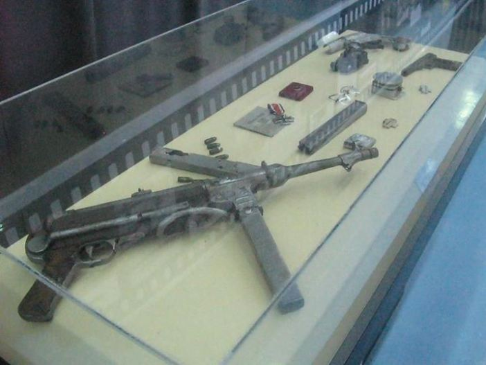 An MP-40, an Iron Cross and other items salvaged from the Ju-52 shot down in Leros.
