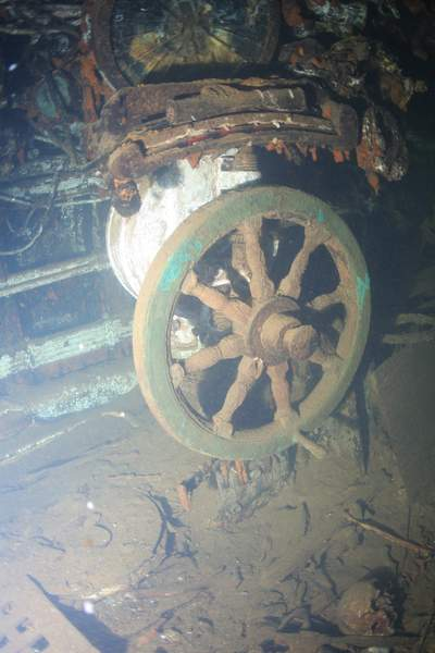 Remains of drowned sailors are scattered across the submarine's floor. The submarine remains their final resting place and watery grave.